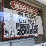 image of sign in window reading 'do not feed the zombies' suggesting that coronavirus is not the zombie apocalypse
